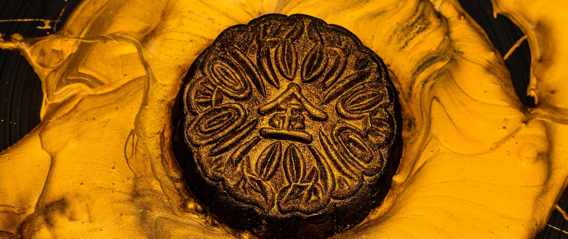 Mooncake on a Black Plate with gold paint